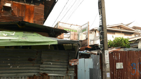 Slumming, tilt shot abandoned partially destroyed small houses Footage