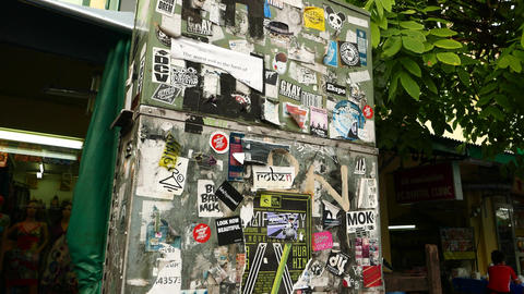 Street box plastered with paper advertisements, pieces and snatches, old and new Footage