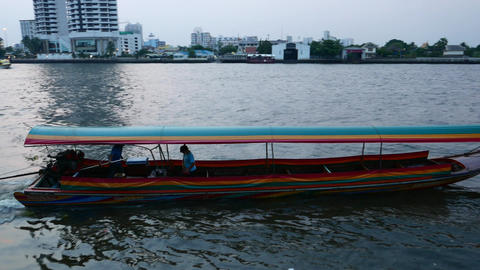Long tail boat loudly departs and run away, Chao Phraya river in dusk Footage