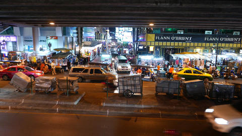 Vendor carts covered parked under viaduct, lively asian night urban city area Footage