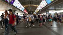 Overcrowded modern metro station train arrive asian passengers struggle about Footage