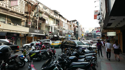 Siam Square 2 alley full of parked motorcycle, POV camera walk along footpath Footage