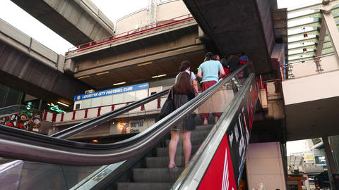 Asian pedestrians travelling up on escalator, to Siam BTS concourse level Footage