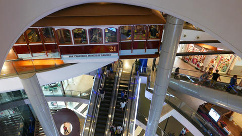 Restaurant decorated with railway carriage, within shopping complex, escalators Footage