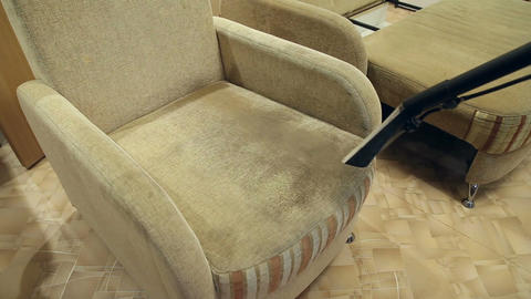 Service cleaning dirty sofa and chairs with special tool Footage