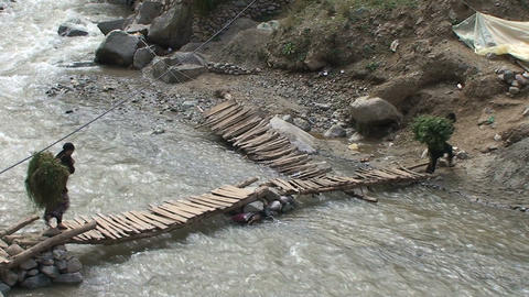 Man walks over Ourika river Footage