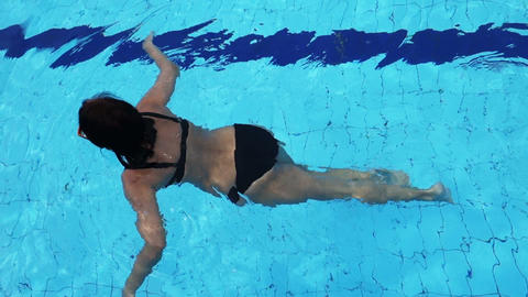 Slowmotion Of A Attractive Woman Swimming In The Pool stock footage