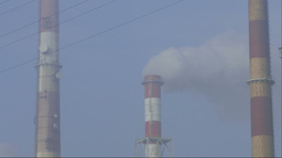 Smog in the air and smoking chimneys of a coal power plant Stock Video Footage