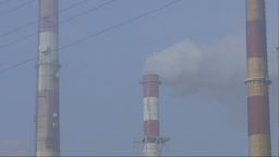Smog in the air and smoking chimneys of a coal power plant Footage