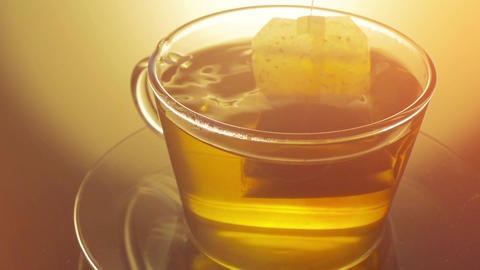 Glass cup of tea with teabag close up Footage