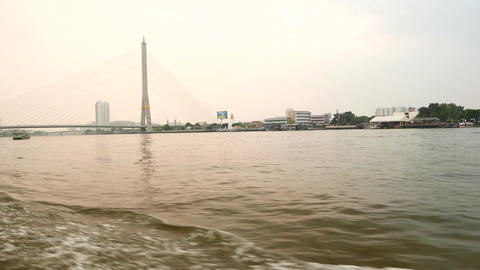 Rama VIII bridge and Chao Phraya river bank from running express boat Footage