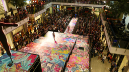 Mottled fashon show stage and podium, view from above. Many people watch show Footage