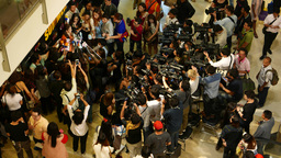 Trendy journalists crowded around fashion designer after show, many cameras Footage