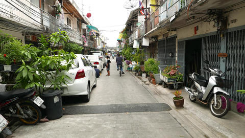 POV walk through alley, lively inner-city area, low-rise buildings, Asian people Footage