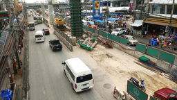 Construction site in middle of road, concrete column build up, support structure Live Action