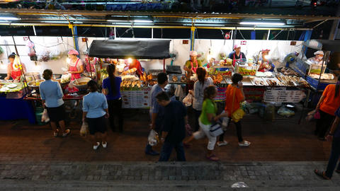 Fry and grill fish, chicken legs, street fast food stands at sideway, night time Footage