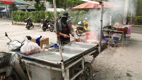Grille cart at outdoor market parking, roasting meat on charcoal, glide shot Footage