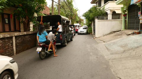 Traffic jam in very narrow alley, tiny street two-way traffic blocked tight pass Live Action