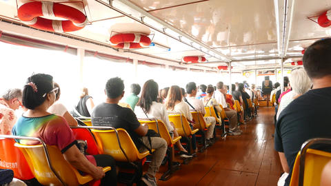 Man pay fare and receive ticket from conductor, aisle view of express boat Footage