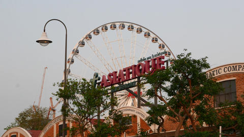 Asiatique Signboard In Dusk. Against Moving Ferris Wheel On Background stock footage