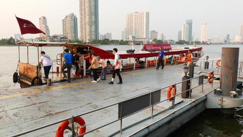 People boarding free shuttle boat, walk across pier to long vessel Footage