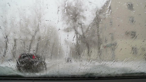 Snow And Rain Flows Over The Windshield Of The Car stock footage