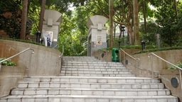 Walking up the staircase to Hong Kong park entrance Live Action