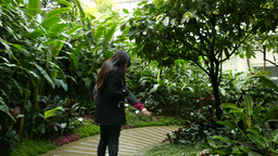 Two girls in botanical garden. Tropical orangery in Hong Kong Park Footage