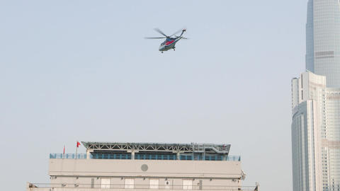 Helicopter take off from Hong Kong - Macau Ferry Terminal roof helipad Footage