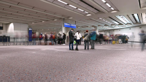 Ultra-fast timelapse of departure gate queue and still group of people Footage