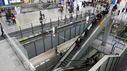Airport escalator travelling down. View from upper floor Footage