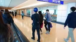 Young man slowly walking near the travellator in airport arrival area Footage
