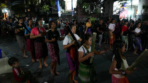 Young Balinese girls group rehearse Ngrupuk parade traditional orchestral music Footage