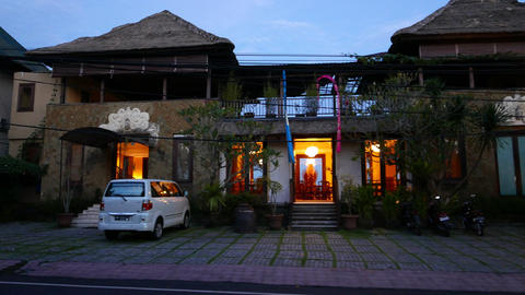 Balinese luxurious suite entrance building in dusk, slide-panning shot Footage