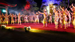 Modern Balinese dance performance at night stage, large troupe steps in rhythm Footage