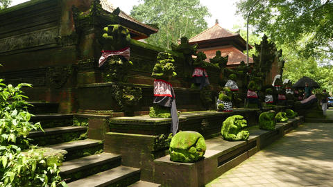 Guards around Temple of Death, stone sculptures against Pura Dalem walls Footage