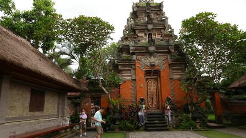 Ubud Palace long slide shot, high decorated towering gate seen from first yard Footage
