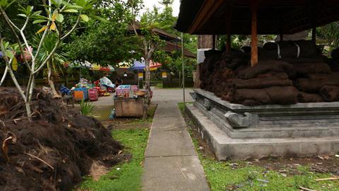 Backyard building and path, Hindu temple site, Goa Gajah, glide shot Footage