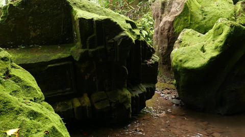 Mysterious Boulder, Ancient Mossy Ruin Lie At Shallow Riverbed stock footage