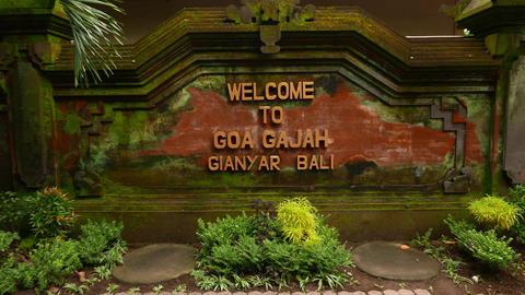 Welcome to Goa Gajah inscription on brick wall, parallax shot Footage