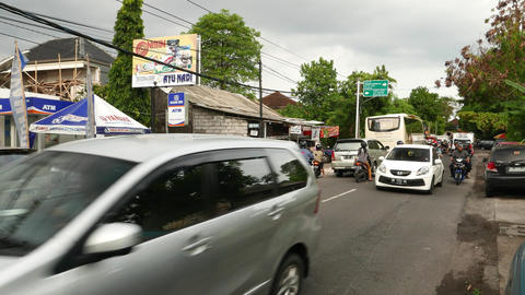 Dense traffic on balinese street, Denpasar outskirts Footage