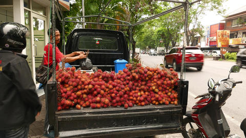 Rambutan Seller On Street, Weight And Pack Bunch, Open Trailer stock footage