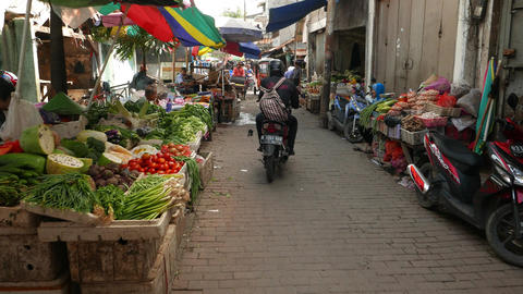 Camera rush through souk street, vegetable selling, trishaw drive towards Footage