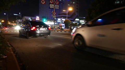 Busy traffic night street low angle, horn signal, junction traffic light Live Action