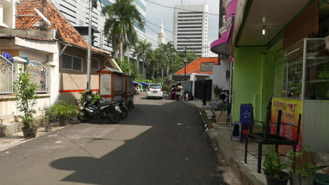 Kebon Sirih Barat street turn right, central Jakarta townhouses area, sunny view Footage