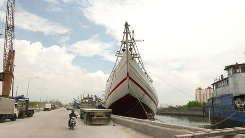 Gang-plank stairs to wooden pinisi boat, mooring at old port, Jakarta Live Action