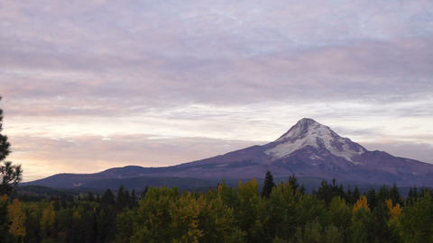 The Sun Rises on Mount Hood Clouds Pass Overhead Footage