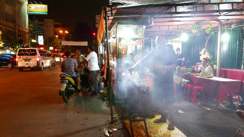 Swirls of smoke from roasting chicken kebab, night street kitchen, man cooking Footage