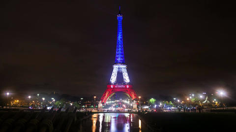 A Timelapse View on Eiffel Tower in Paris by Night with France Flag Colors Footage