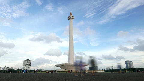 National Monument in Jakarta city against clouds timelapse Footage